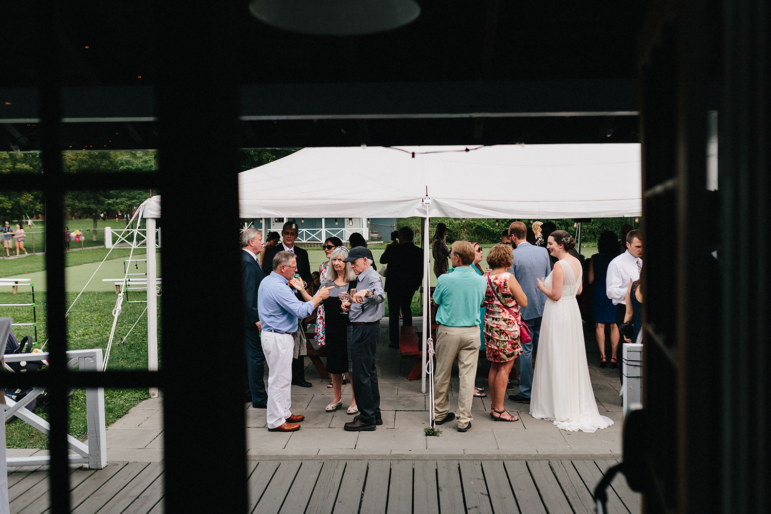 Toronto-Island-Wedding-Toronto-Best-Film-Wedding-Photographers-3b-photography-analog-photography-wards-island-clubhouse-junebug-weddings-vintage-venue-reception-cocktail-hour-candid-guests-mingling-artistic-creative.jpg