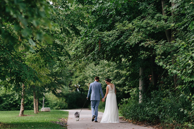 Toronto-Island-Wedding-Toronto-Best-Film-Wedding-Photographers-3b-photography-analog-photography-wards-island-clubhouse-junebug-weddings-vintage-venue-reception-couples-portraits-walking-away-with-terrier-otto.jpg