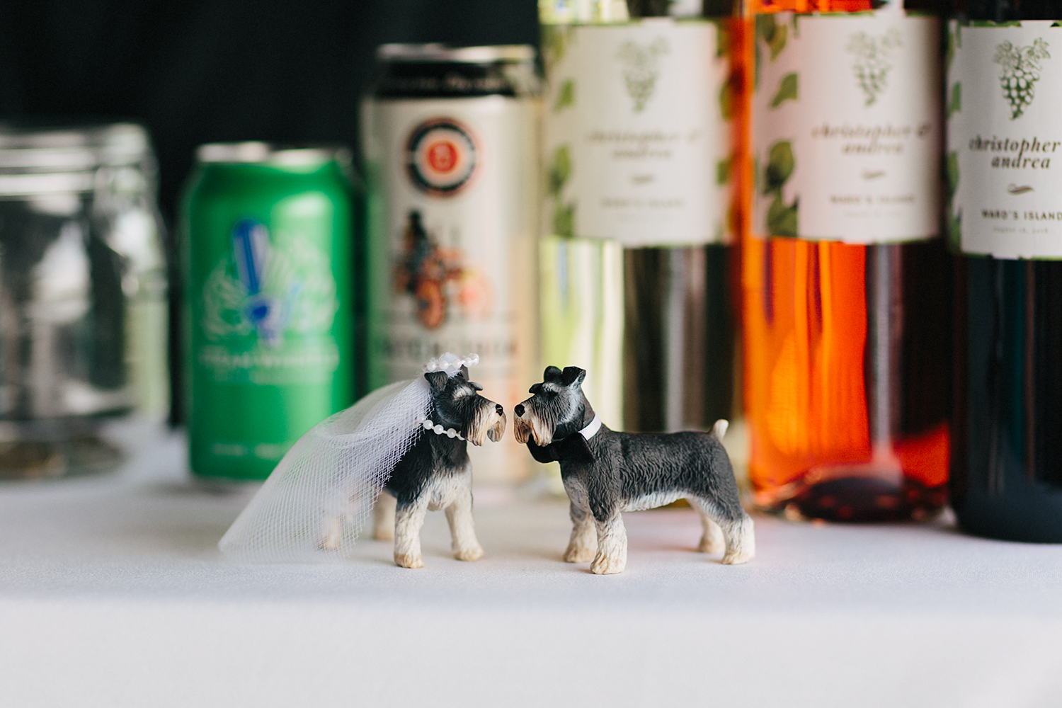 Toronto-Island-Wedding-Toronto-Best-Film-Wedding-Photographers-3b-photography-analog-photography-wards-island-clubhouse-junebug-weddings-vintage-venue-reception-cocktail-hour-candid-guests-mingling-details-cute-dog-terrier-cake-topper.jpg
