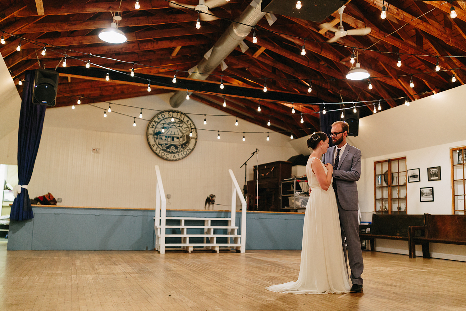 Best-Film-Wedding-Photographers-3b-photography-analog-photography-wards-island-clubhouse-junebug-weddings-vintage-venue-reception-guests-speeches-candid-moments-memories-dancing-benches-bride-and-groom-intimate-romantic-dancing-in-the-gym.jpg