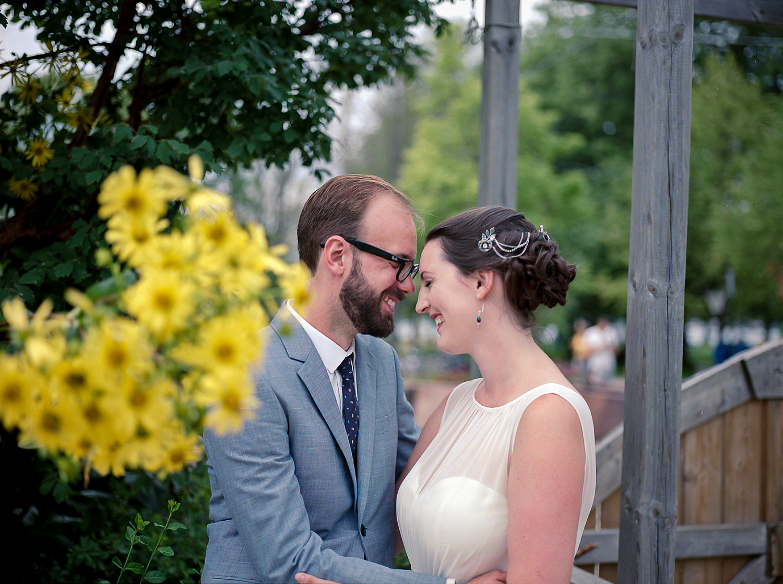 Best-Analog-Medium-format-film-wedding-photographers-Toronto-Elopement-photography-Toronto-Island-Cafe-Summer-Wedding-Portra-160-Hasselblad-501cm_Timeless-Candid-Portrait-of-bride-and-groom-candid-laugh.jpg