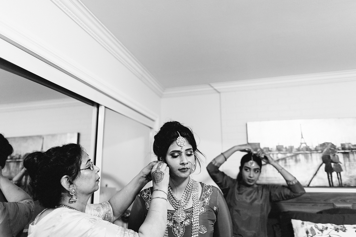 Toronto's-Best-Wedding-Photographers-Multicultural-wedding-specialty-ontario-port-perry-getting-ready-bride-putting-on-jewellery-with-moms-help.jpg