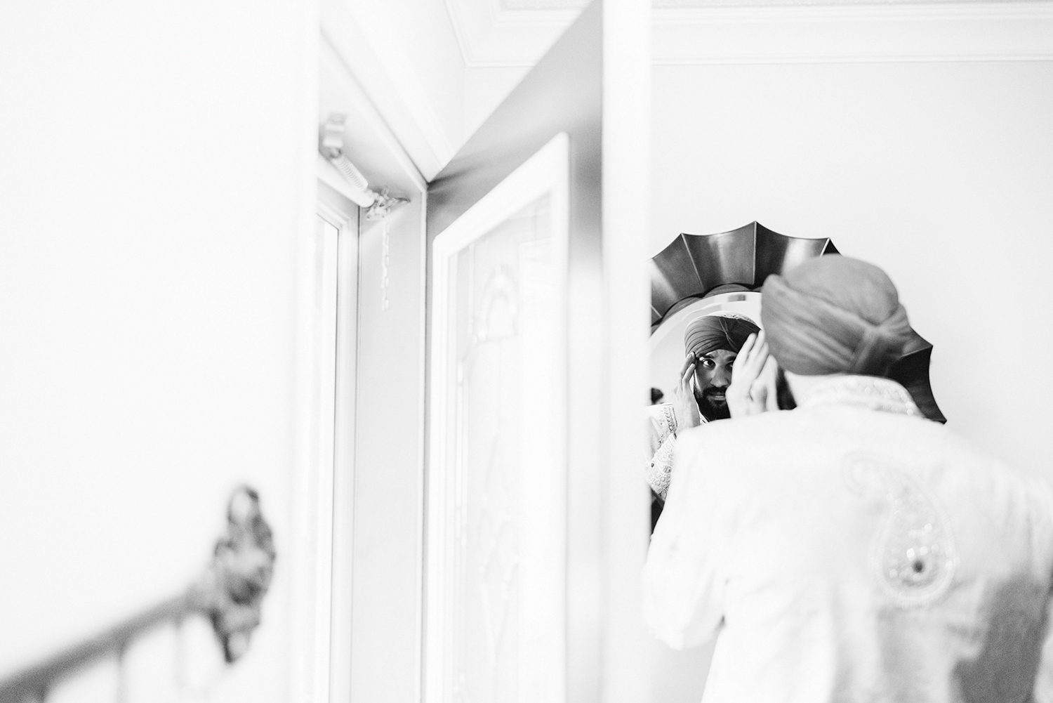 Toronto-Photojournalism-wedding-photographers-3B-Photography-Candid-Documentary-Film-Photography-Analog-Ontario-Hamilton-Port-Perry-Venue-Groom-Getting-Ready-putting-on-turban-sikh-ceremony-traditional-garments-reflection.jpg