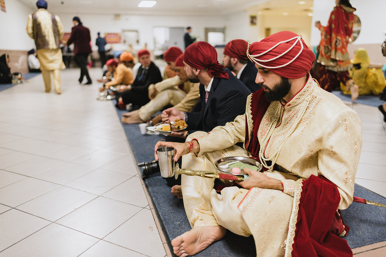 Toronto-Photojournalism-wedding-photographers-3B-Photography-Candid-Documentary-Film-Photography-Analog-Ontario-Hamilton-Port-Perry-Venue-temple-ceremony-sikh-pre-ceremony-traditions-meal-moments-groom-eating.jpg