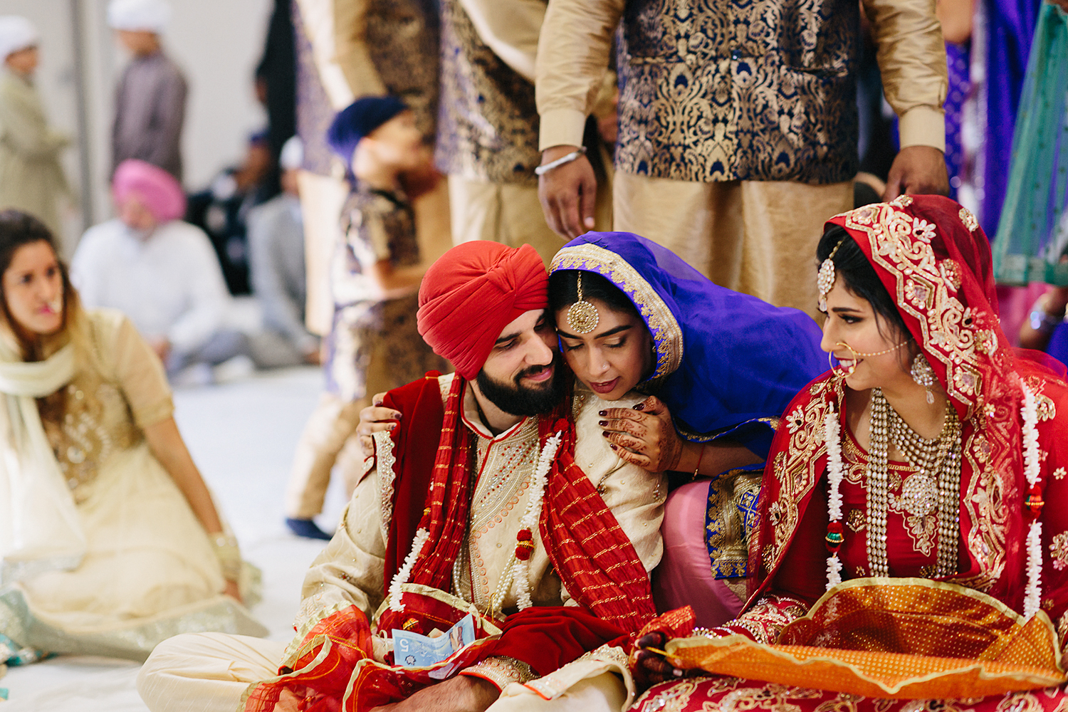 Toronto's-Best-Film-Wedding-Photographers-Multicultural-wedding-specialty-ontario-port-perry-ceremony-at-temple-candid-documentary-film-analog-photography-sikh-ceremony-proud-friends.jpg