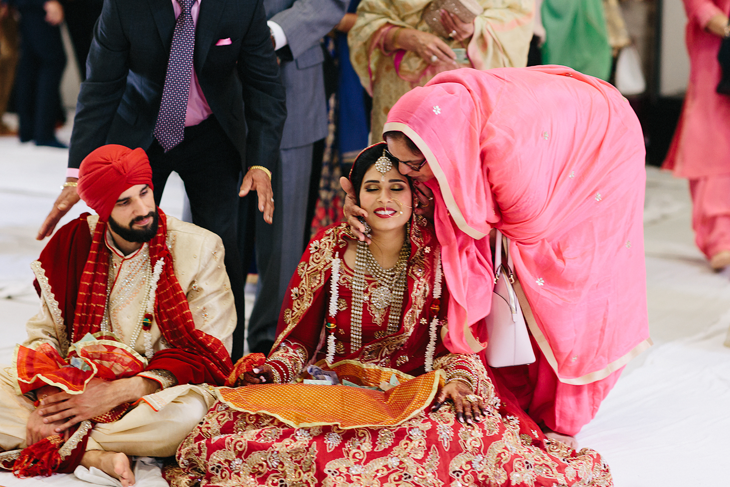 Toronto's-Best-Film-Wedding-Photographers-Multicultural-wedding-specialty-ontario-port-perry-ceremony-at-temple-candid-documentary-film-analog-photography-sikh-ceremony-congratulations.jpg
