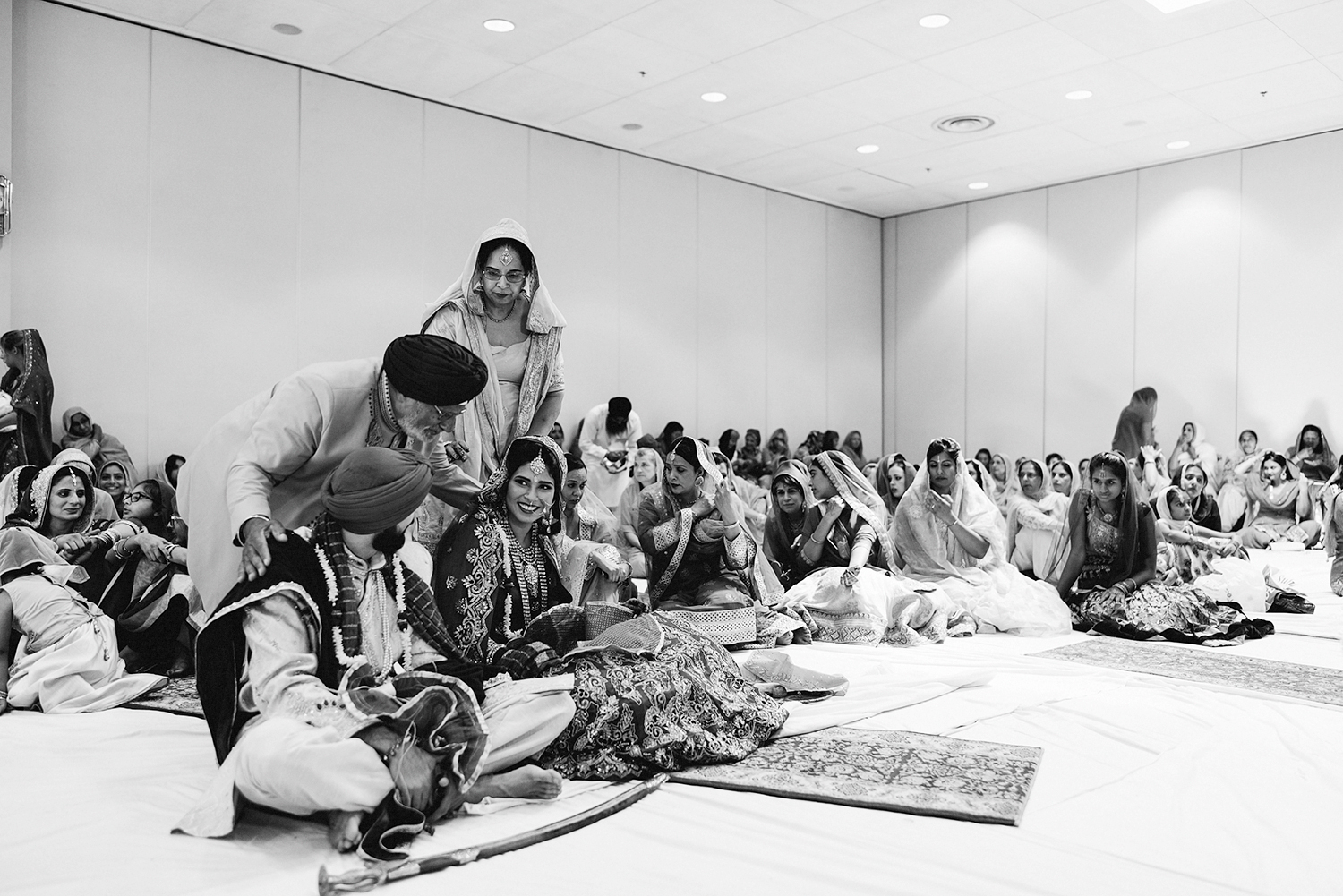 Toronto-Photojournalism-wedding-photographers-3B-Photography-Candid-Documentary-Film-Photography-Analog-Ontario-Hamilton-Port-Perry-Venue-temple-ceremony-sikh-tradition-bride-and-groom-marriage-congratulations-from-dad.jpg