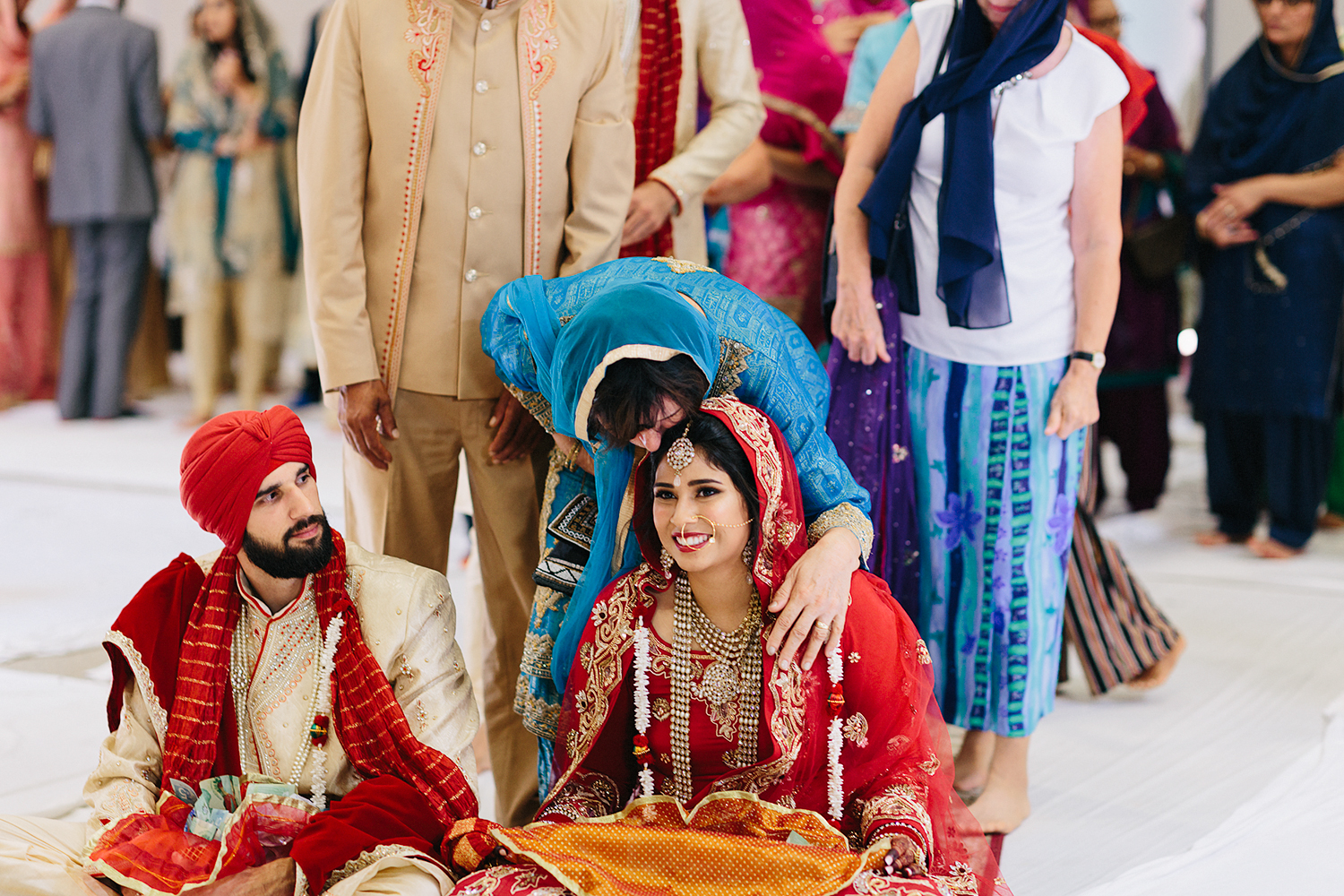 Toronto's-Best-Film-Wedding-Photographers-Multicultural-wedding-specialty-ontario-port-perry-ceremony-at-temple-candid-documentary-film-analog-photography-sikh-ceremony-congratulations-from-parents.jpg