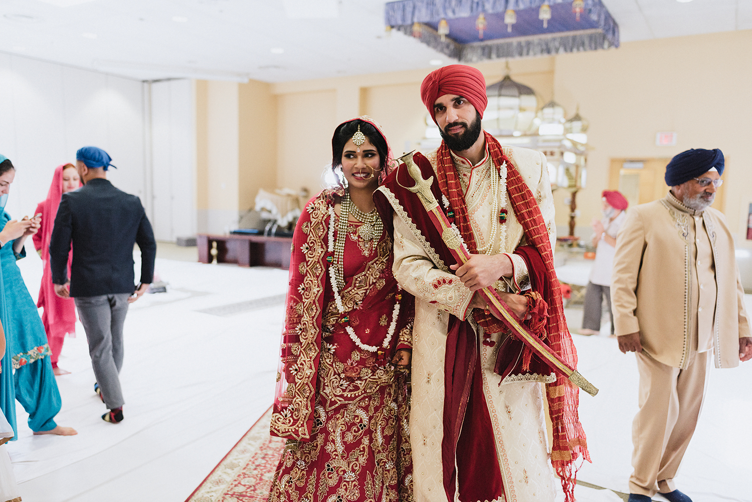 Toronto-Photojournalism-wedding-photographers-3B-Photography-Candid-Documentary-Film-Photography-Analog-Ontario-Hamilton-Port-Perry-Venue-temple-ceremony-sikh-tradition-bride-and-groom-marriage-exiting.jpg