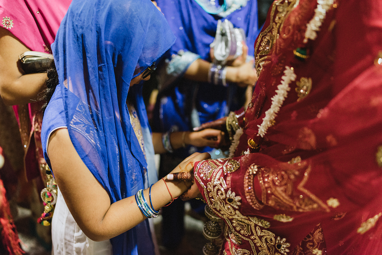 Toronto-Photojournalism-wedding-photographers-3B-Photography-Candid-Documentary-Film-Photography-Analog-Ontario-Hamilton-Port-Perry-Venue-temple-ceremony-sikh-tradition-bride-holding-hands-cute-moment.jpg