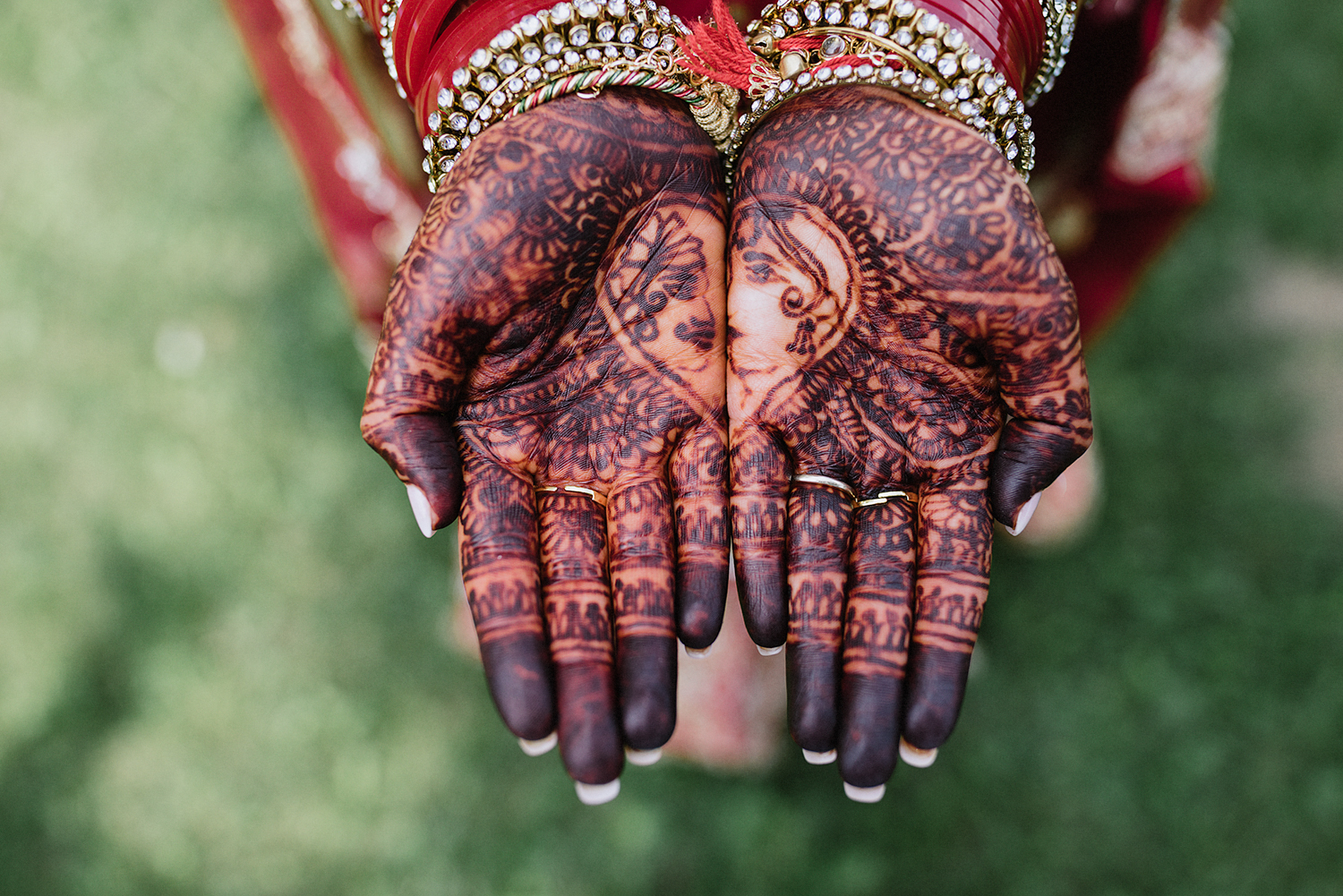 Toronto-Photojournalism-wedding-photographers-3B-Photography-Candid-Documentary-Film-Photography-Analog-Ontario-Hamilton-Port-Perry-best-venues-portrait-of-bride-in-traditional-dress-henna-details-on-hands.jpg