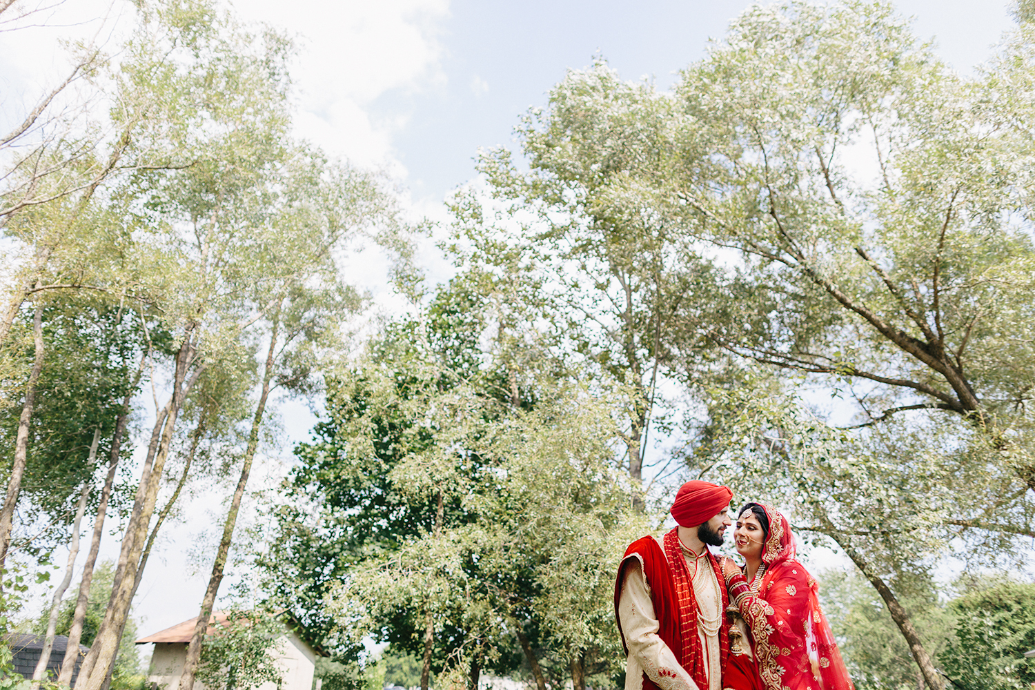 Toronto's-Best-Film-Wedding-Photographers-Multicultural-wedding-specialty-ontario-port-perry-candid-documentary-film-analog-photography-120-35mm-film-portraits-of-sikh-bride-and-groom-in-the-trees-epic-cinematic-artistic.jpg