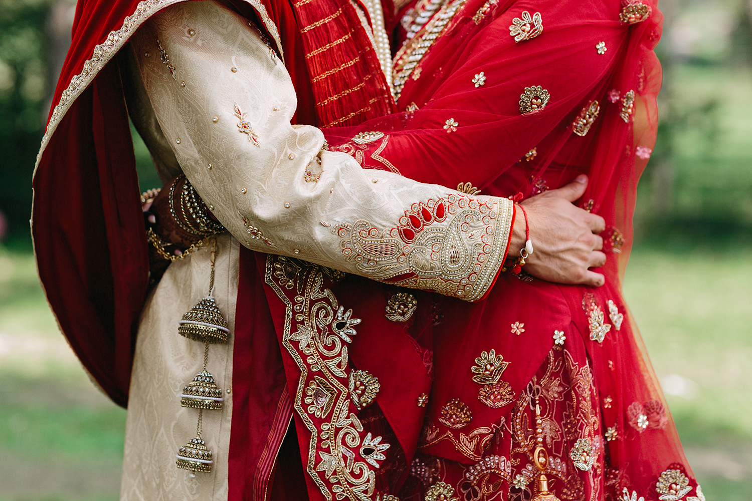 Toronto's-Best-Film-Wedding-Photographers-Multicultural-wedding-specialty-ontario-port-perry-candid-documentary-film-analog-photography-120-35mm-film-portraits-of-sikh-bride-and-groom-cinematic-laughing-together-hugging-hands.jpg