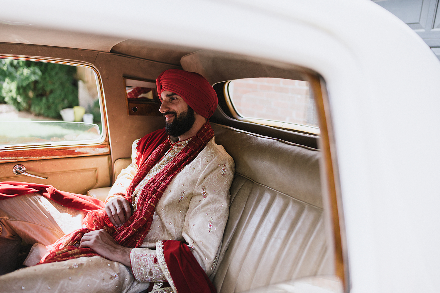 Toronto-Photojournalism-wedding-photographers-3B-Photography-Candid-Documentary-Film-Photography-Analog-Ontario-Hamilton-Port-Perry-best-venues-portrait-of-groom-in-traditional-dress-waiting-in-car.jpg