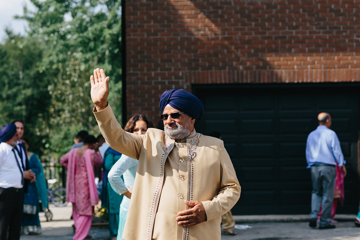 Toronto's-Best-Film-Wedding-Photographers-Multicultural-wedding-specialty-ontario-port-perry-candid-documentary-film-analog-photography-120-35mm-send-off-emmotional-bride-crying-happiness-goodbye-leaving-in-car-dad-waving.jpg