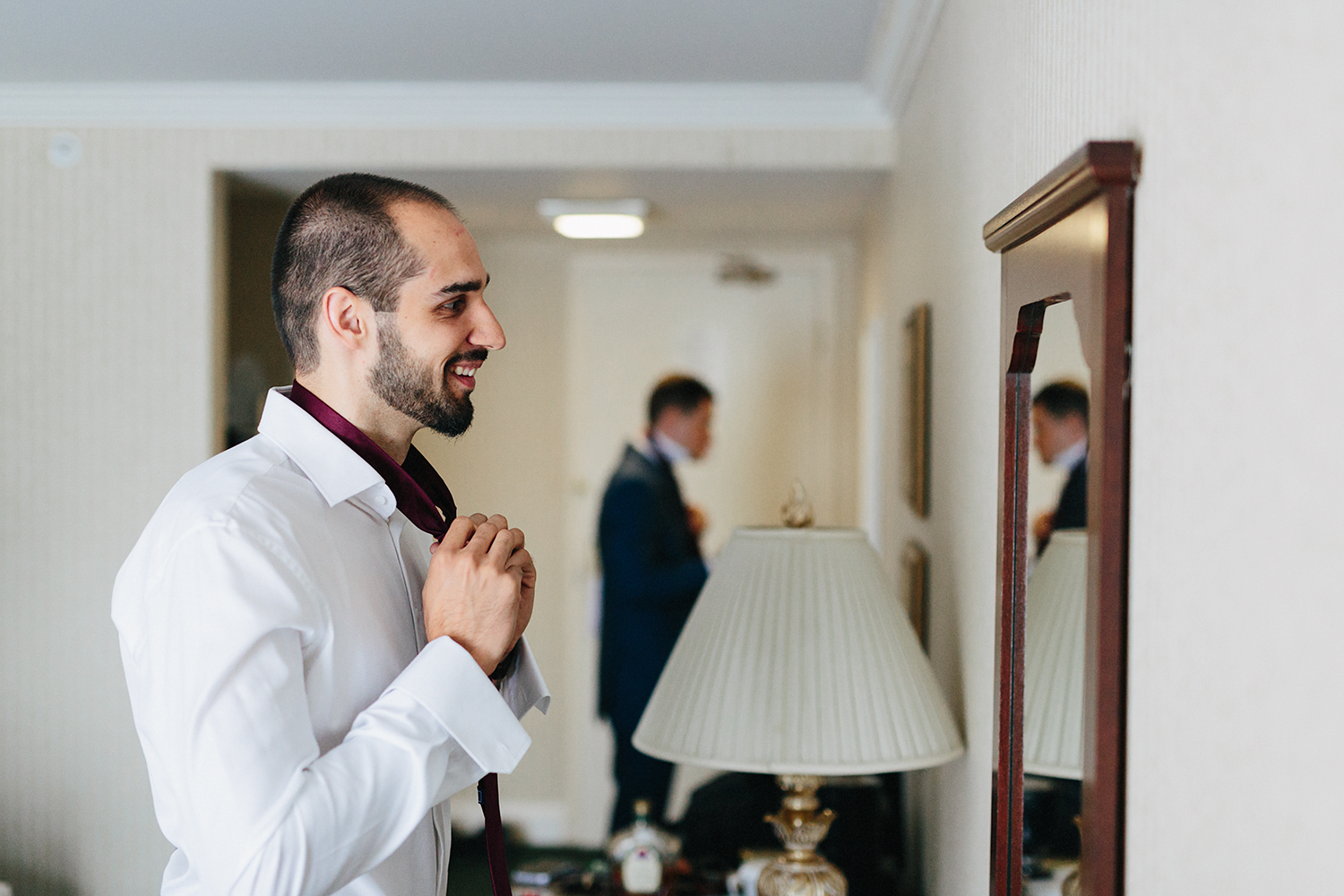 Toronto's-Best-Film-Wedding-Photography-3B-Photography-Brian-Batista-Bettencourt-Multicultural-wedding-day-two-Hamilton-Grimsby-Toronto-Wedding-Getting-Ready-Groom-getting-dressed-tying-tie.jpg