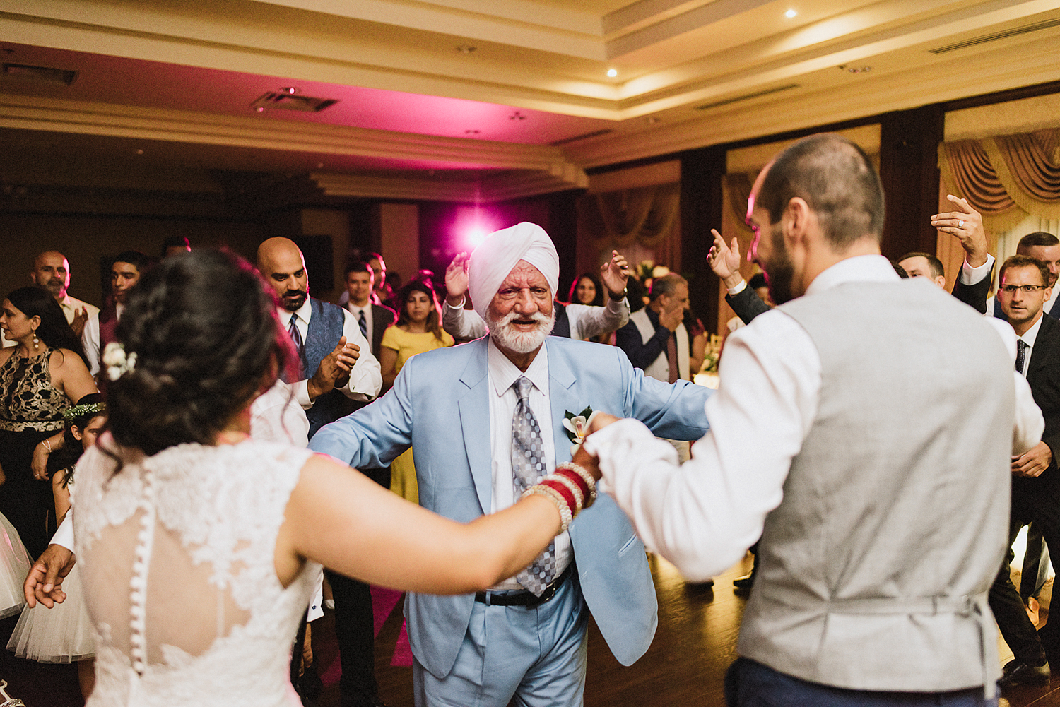 Toronto-Photojournalism-wedding-photographers-3B-Photography-Candid-Documentary-Film-Photography-Analog-Ontario-Extremely-intimate-and-quiet-moment-between-bride-and-groom-dancing-with-grandpa.jpg