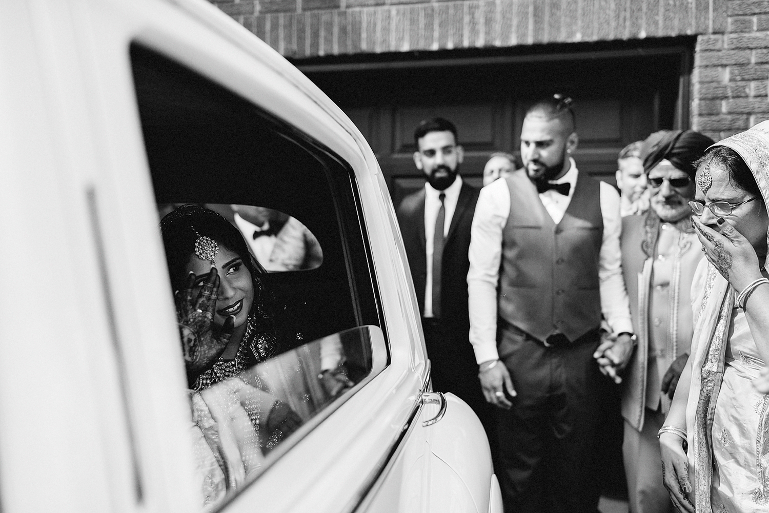 Toronto-Photojournalism-wedding-photographers-3B-Photography-Candid-Documentary-Film-Photography-Analog-Ontario-Hamilton-Port-Perry-Venue-Groom-Getting-Ready-putting-on-turban-sikh-ceremony-emotional-as-she-leaves-in-vintage-car.jpg
