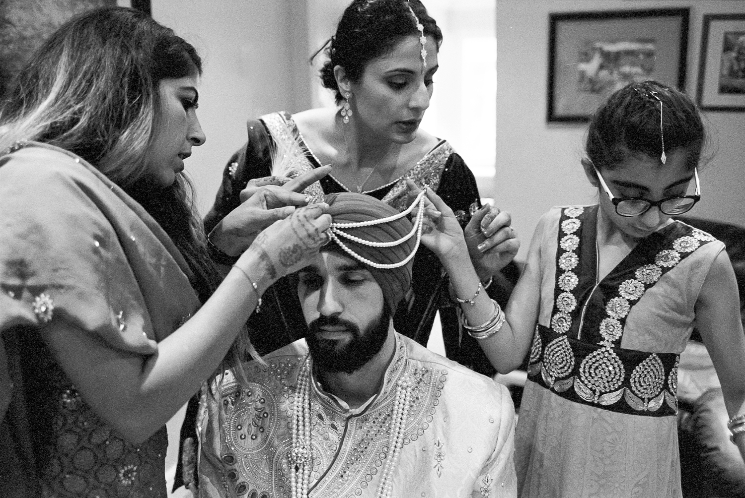 Best-Analog-Film-Wedding-Photographers-in-Toronto-3B-Photography-Brian-B-Bettencourt-Leica-M4P-Kodak-Film-Portra-400-Groom-Getting-ready-putting-on-traditional-turban-with-help-from-family.jpg