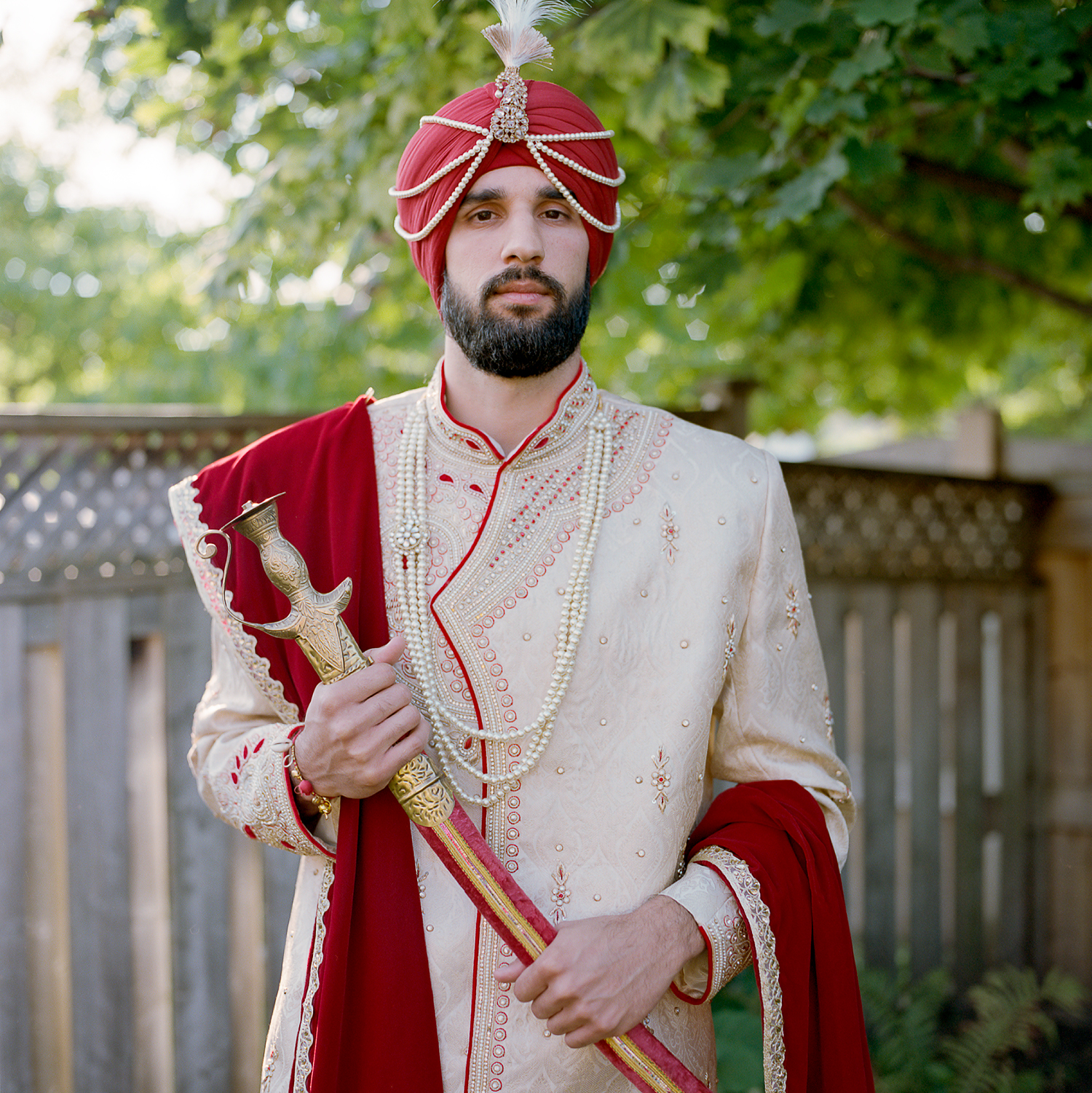 Best-Film-Wedding-Photographer-Toronto-3B-Photography-Brjann-Batista-Bettencourt-Edotiral-documentary-wedding-photography-candid-portrait-Medium-Format-Film-Kodak-Portra-800-Minimal-Portrait-of-Groom-in-traditional-groom-garments.jpg
