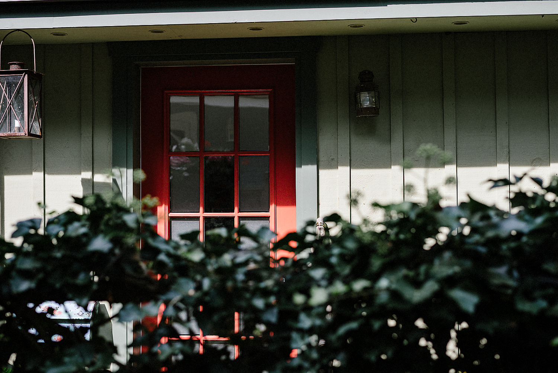 Best-Wedding-Photographers-in-Toronto---Toronto-Island-Cafe-Wedding-Bride-Getting-Ready-in-vintage-country-house-on-Toronto-Island-Boho-Bride-Red-Door-Detail.jpg