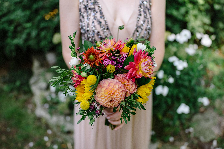 Best-Wedding-Photographers-in-Toronto---Toronto-Island-Cafe-Wedding-Bride-Getting-Ready-in-vintage-country-house-on-Toronto-Island-Boho-Bride-Colourful-Bouquet-of-Flowers.jpg