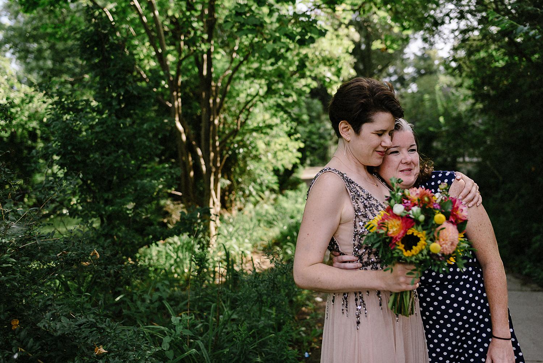 Toronto-Island-Cafe-Clubhouse-Wedding-Boho-Hipster-Bride-and-Groom-Modern-Vintage-Wedding-Documentary-Style-Wedding-Photography-Photojournalistic-Style-3B-Photography-Bride-and-Groom-Portraits-candid-hug.jpg