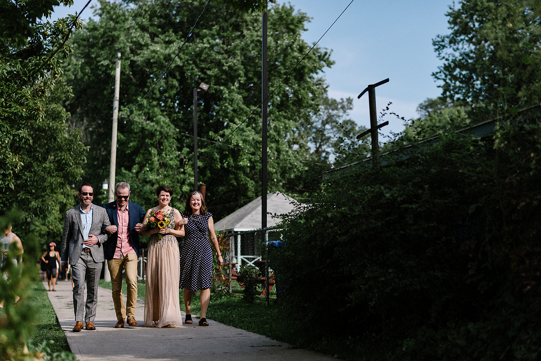 Toronto-Island-Cafe-Club-house-wedding-ceremony-photography-best-photojournalistic-documentary-wedding-photographers-toronto-hip-boh-cool-bride-and-groom-emotional-intimate-toronto-island-wedding-siblings-walking-bride-down-asile-.jpg