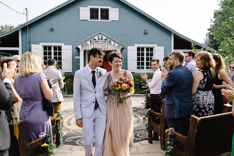 Toronto-Island-Cafe-Club-house-wedding-ceremony-photography-best-photojournalistic-documentary-wedding-photographers-toronto-hip-boh-cool-bride-and-groom-emotional-intimate-toronto-island-wedding-ceremony-bride-and-groom-exit.jpg