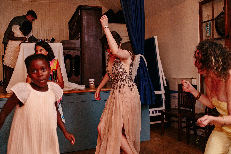 Best-Wedding-Photographers-Toronto-with-documentary-style-photojournalistic-wedding-photographer-editorial-cool-hip-timeless-Intimate-Toronto-Island-Cafe-Clubhouse-Wedding--Bride-Dancing-Hard-Analog-Film-.jpg