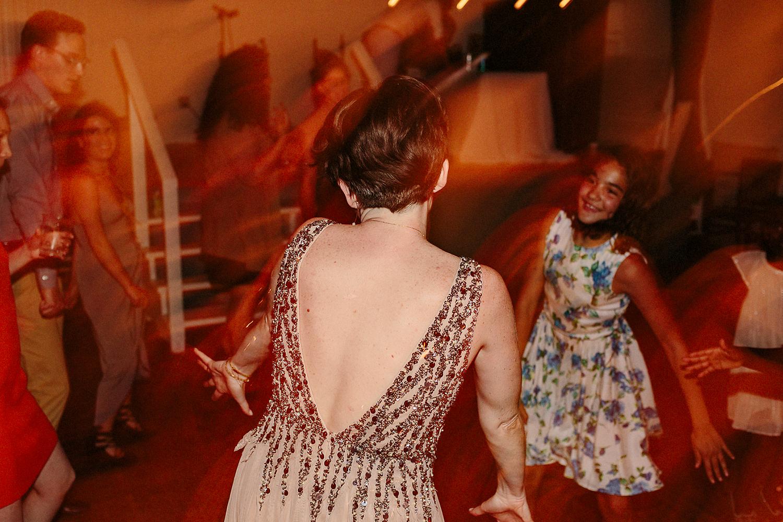 Best-Wedding-Photographers-Toronto-with-documentary-style-photojournalistic-wedding-photographer-editorial-cool-hip-timeless-Intimate-Toronto-Island-Cafe-Clubhouse-Wedding--Bride-Dancing-Hard-Analog-Film-Photographer-Toronto.jpg