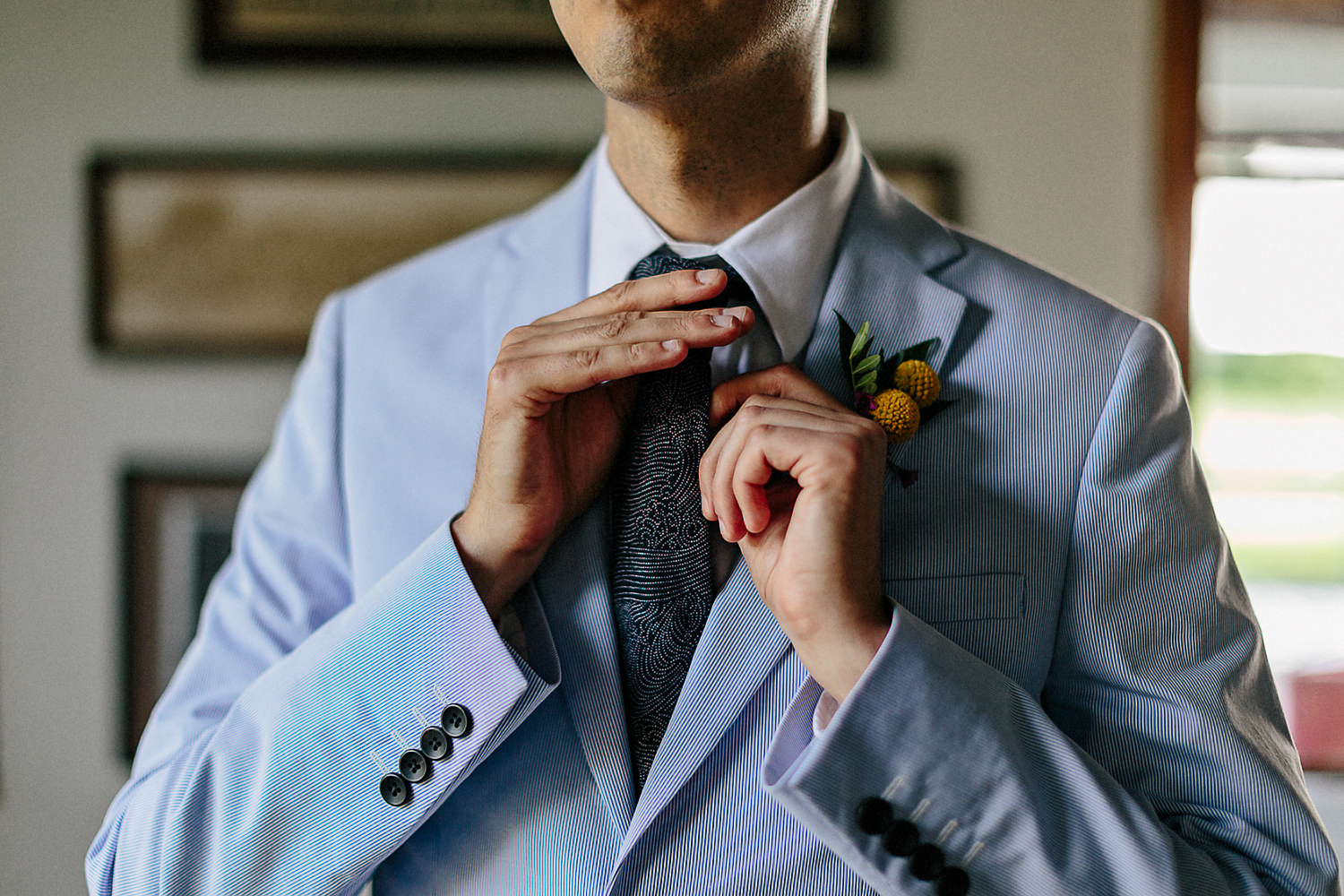 Best-Wedding-Photographers-Toronto-with-documentary-style-photojournalistic-wedding-photographer-editorial-cool-hip-timeless-Intimate-Vintage-Toronto-Island-Cafe-Clubhouse-Wedding-Groom-Candid-Getting-Ready-Fixing-tie-in-reflection.jpg