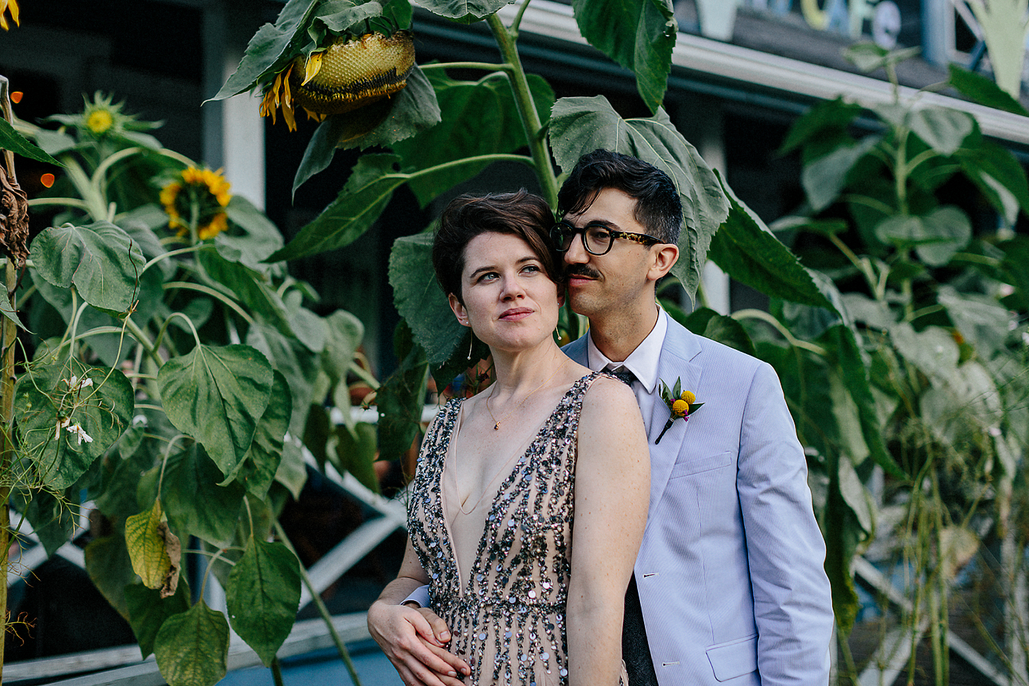 Best-Wedding-Photographers-Toronto-with-documentary-style-photojournalistic-wedding-photographer-editorial-cool-hip-timeless-Intimate-Toronto-Island-Cafe-Clubhouse-Wedding-portrait-with-sunflowers.jpg