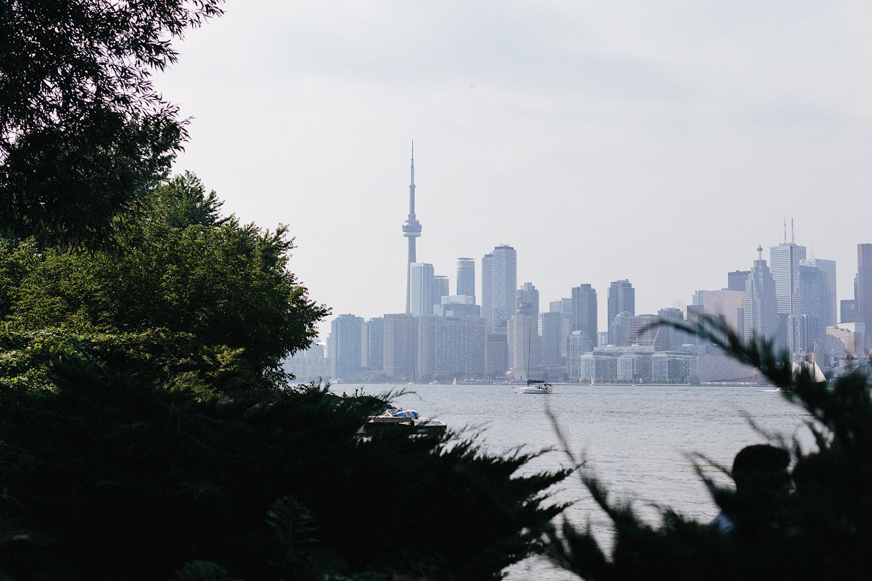 Best-Photographers-in-Toronto-Analog-Film-Toronto-Island-Wedding-Wards-Island-Clubhouse-Venue-small-intimate-hipster-alternative-couple-portraits-best-view-of-the-toronto-skyline-ever.jpg