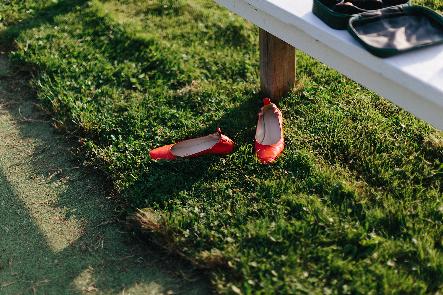Best-Photographers-in-Toronto-Analog-Film-Toronto-Island-Wedding-Wards-Island-Clubhouse-Venue-small-intimate-hipster-alternative-vintage-inspired-wedding-cocktail-hour-lawn-bowling-games-guests-playing-shoes-off.jpg