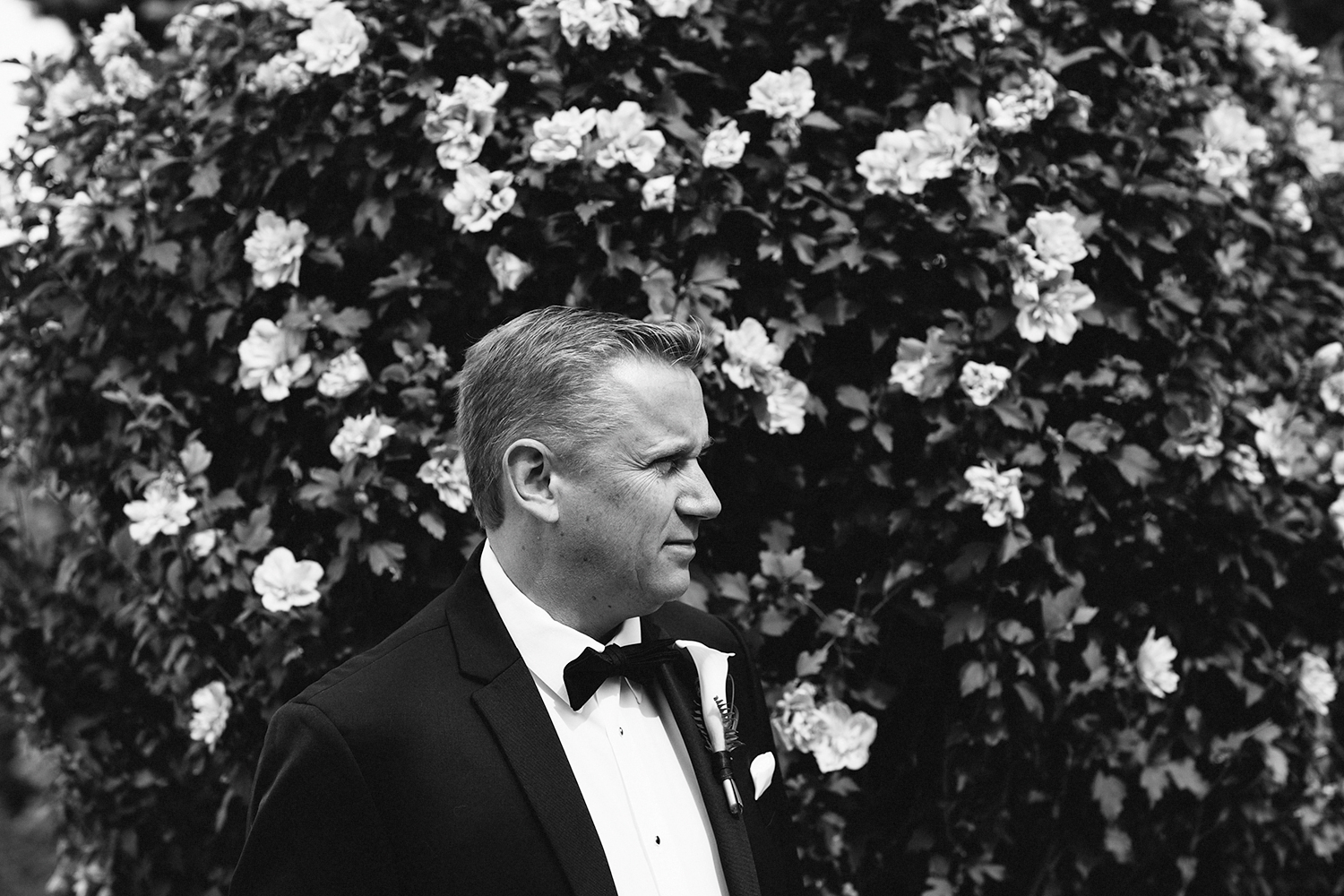 Niagara-on-the-Lake-Wedding-Photographers-Best-in-Toronto-Port-Dalhousie-curling-club-venue-mature-couple-wedding-inspiration-airbnb-groom-getting-ready-portrait-in-tuxedo-artistic-minimalist.jpg
