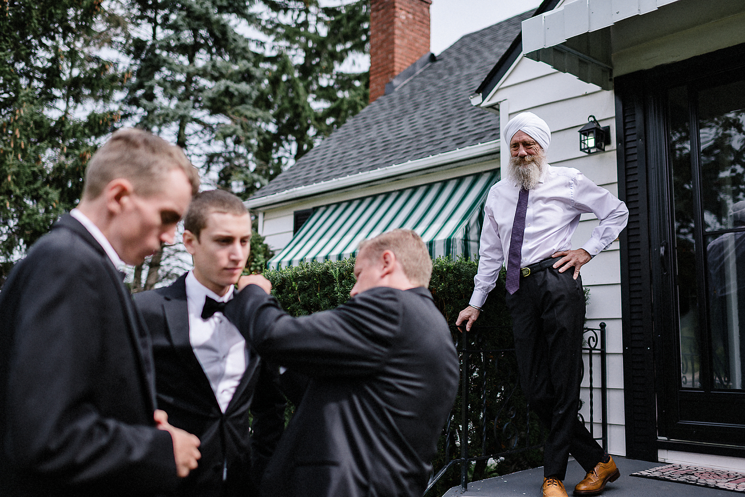 Toronto-Wedding-Photographers-with-natural-photojournalistic-documentary-style-3b-photo-Niagara-on-the-Lake-Wedding-Getting-REady-in-Port-Dalhousie-Granpa-candid.jpg