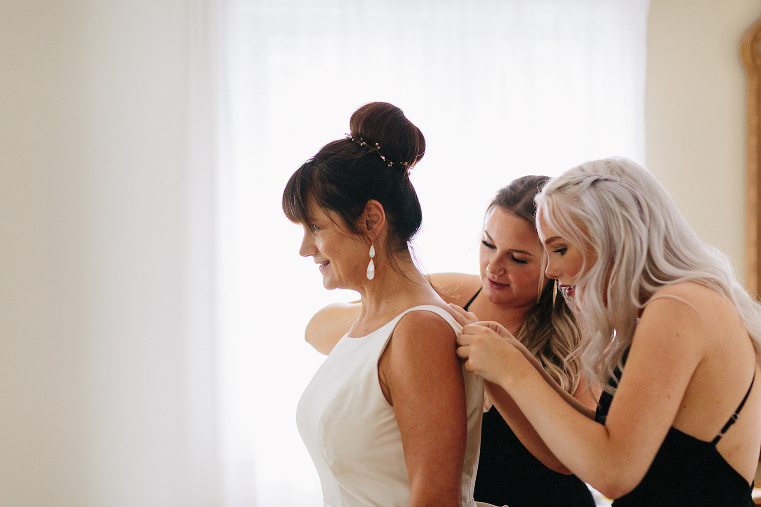 Niagara-on-the-Lake-Wedding-Photographers-Best-in-Toronto-Port-Dalhousie-curling-club-venue-mature-couple-wedding-inspiration-bride-getting-ready-at-childhood-home-wedding-dress-simple-elegant-zipped-up-bridesmaids.jpg