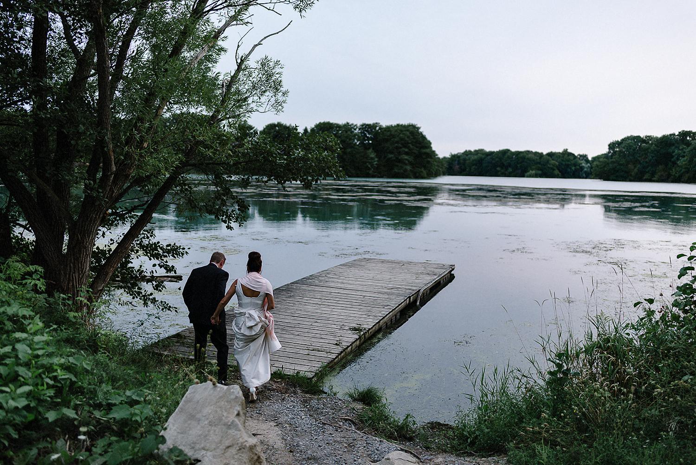 Best-Wedding-Photographers-Toronto-3B-photo-Brian-B-Bettencourt-Candid-Natural-Photojournalistic-Documentary-wedding-photography-candid-outdoor-sunset-portraits-near-water-pink-sky-beautiful.jpg