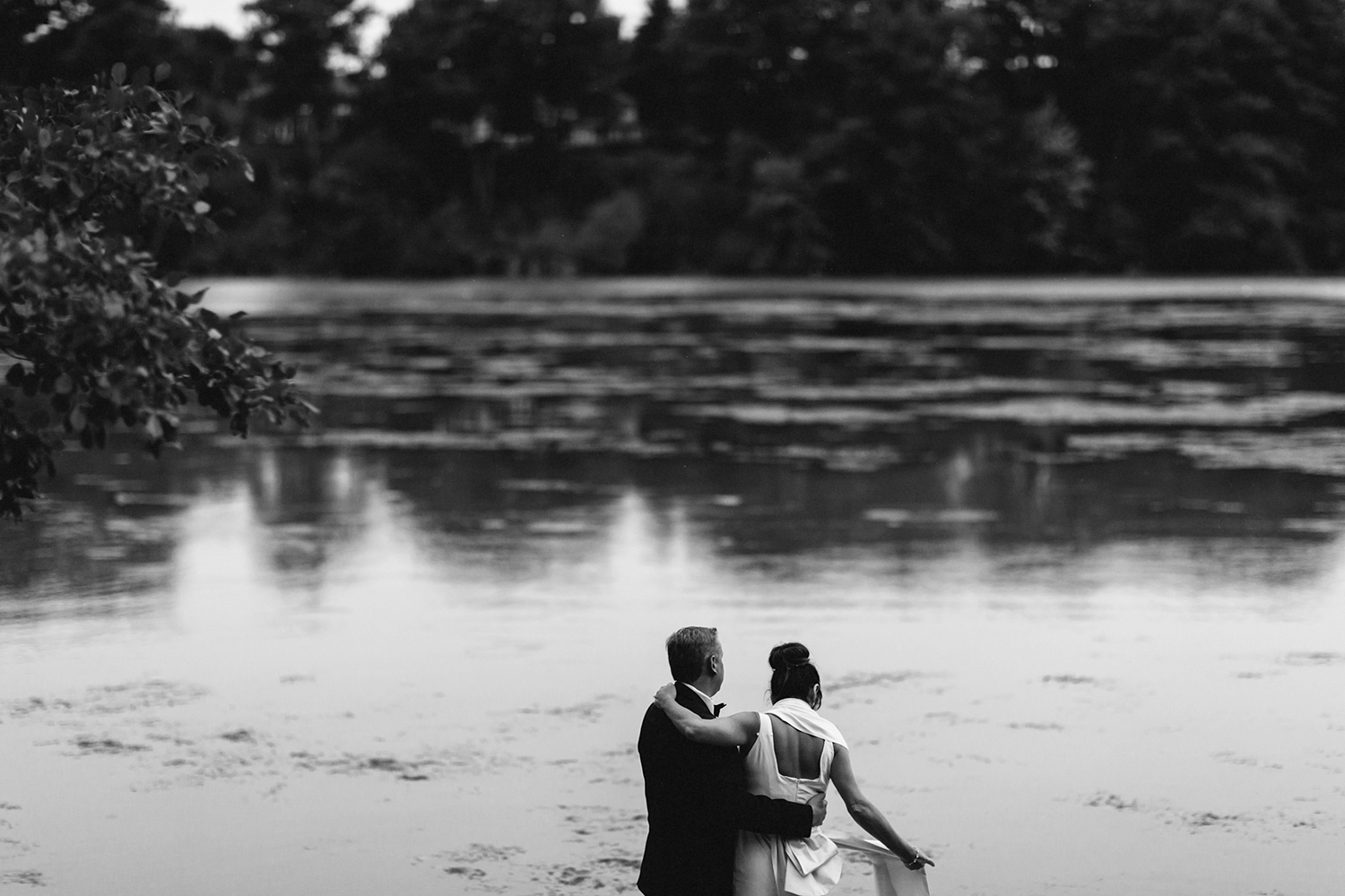 Best-Wedding-Photographers-in-Niagara-on-the-Lake-Toronto-Port-Dalhousie-curling-club-venue-inspiration-photojournalistic-documentary-style-candid-real-couples-portraits-walking-in-wilderness-cottage-on-a-dock-intimate-moment.jpg
