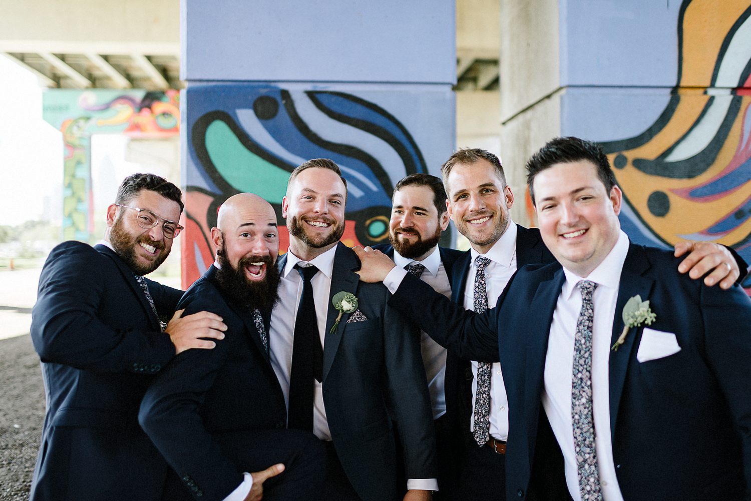 Best-Wedding-Photographers-Toronto-3B-photography-Photojournalistic-documentary-wedding-photography-alternative-cinematic-mood-Bridal-Party-under-the-underpass-candid-portraits-with-groomsmen.jpg