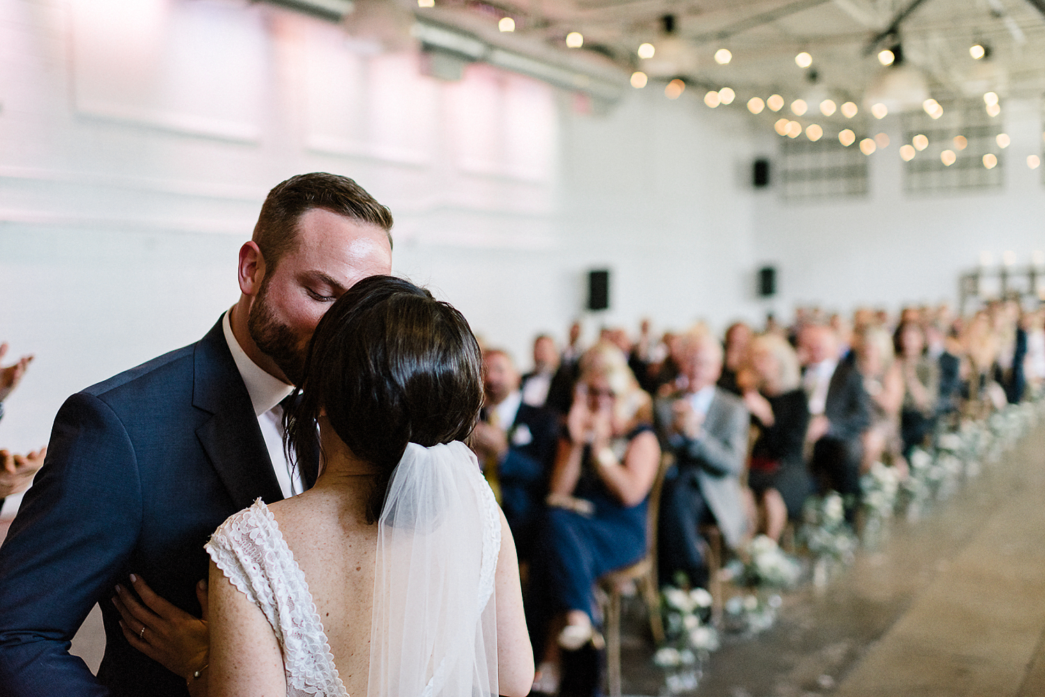 Best-Wedding-photographers-Toronto-NAtural-Candid-wedding-photography-Airship37-Wedding-Ceremony-Entrance-Candid-Moment-Bride-and-GRoom-First-Kiss.jpg