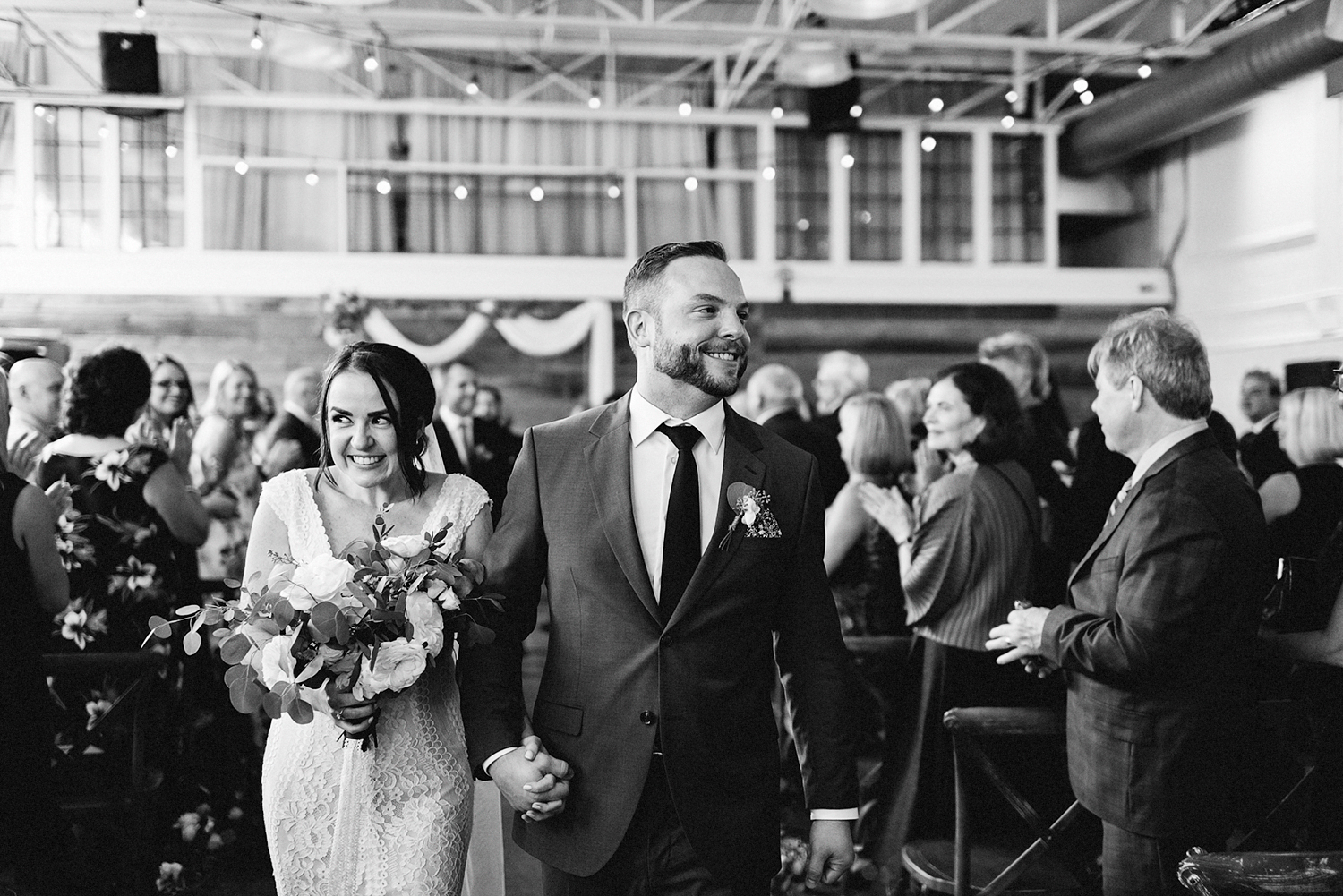 Best-Wedding-photographers-Toronto-NAtural-Candid-wedding-photography-Airship37-Wedding-Ceremony-Entrance-Candid-Moment-Bride-and-Groom-exit-cute-moment.jpg