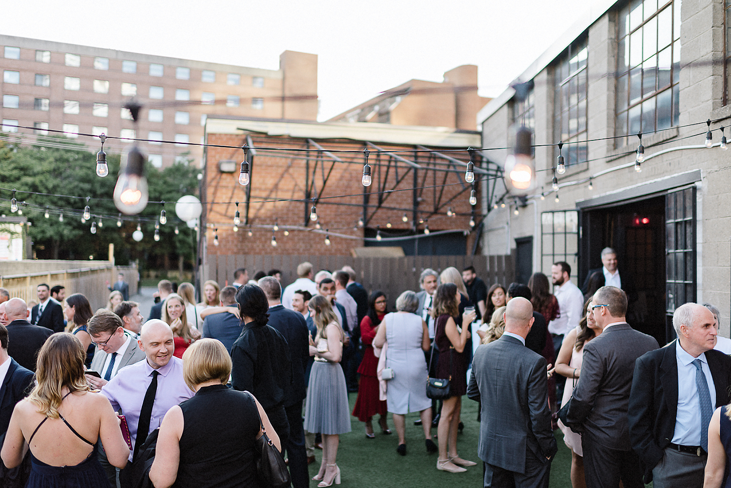 Best-Wedding-photographers-Toronto-NAtural-Candid-wedding-photography-Airship37-Guests-Mingling-on-patio-blue-hour.jpg