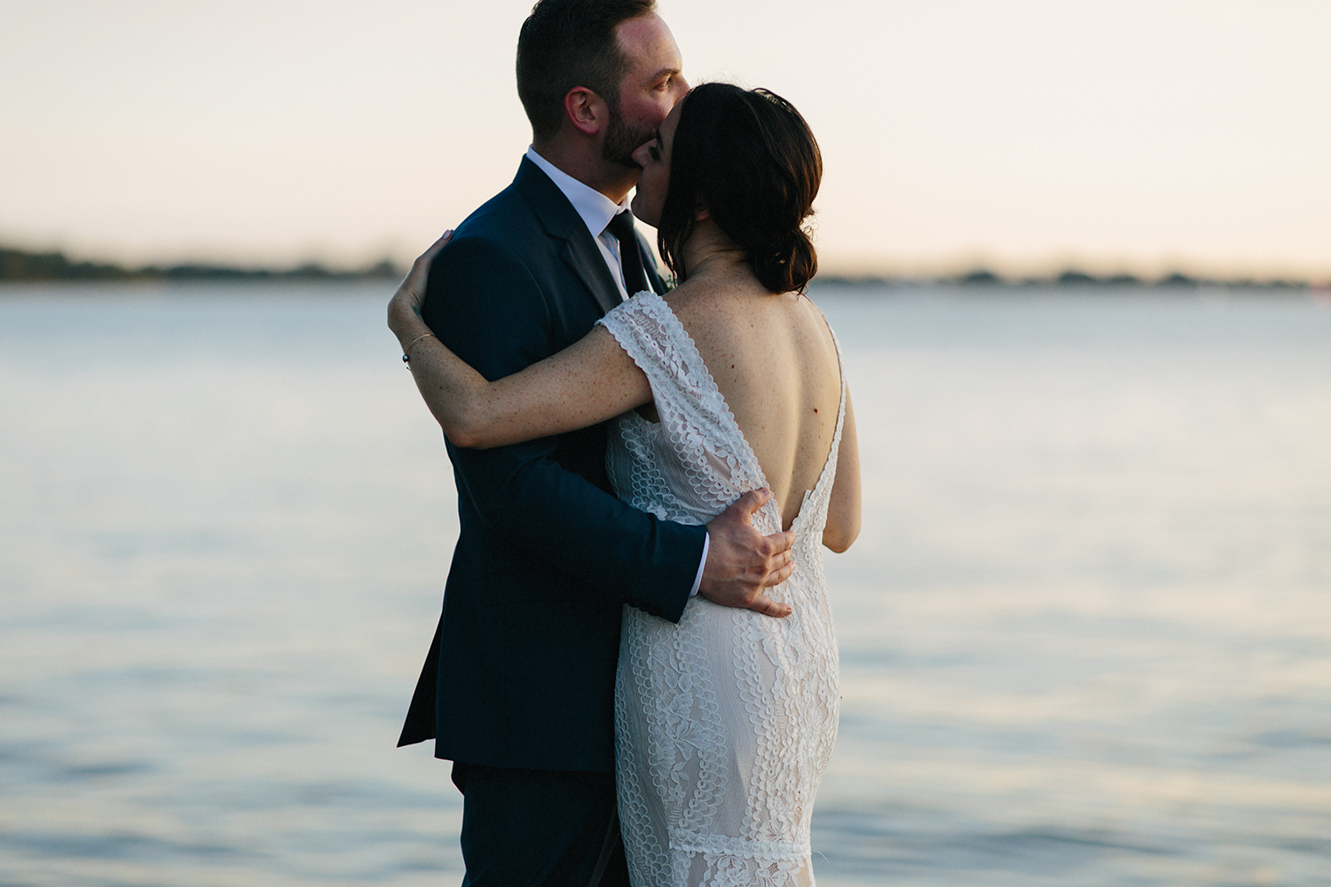 Best-Wedding-photographers-Toronto-Natural-Candid-wedding-photography-Airship37-Sunset-Portraits-City-Skyline-polson-pier-bride-and-groom-portraits-intimate-real-lakeside-moody-cinematic.jpg