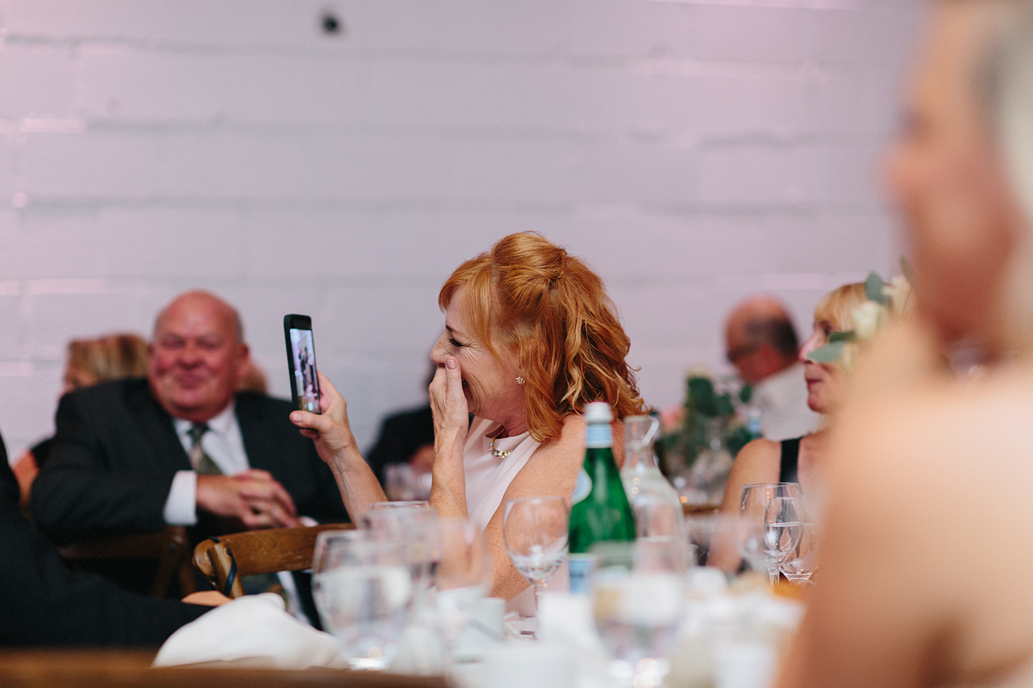 Best-Wedding-photographers-Toronto-NAtural-Candid-wedding-photography-Airship37-Reception-Venue-speeches-guests-laughing-cute.jpg