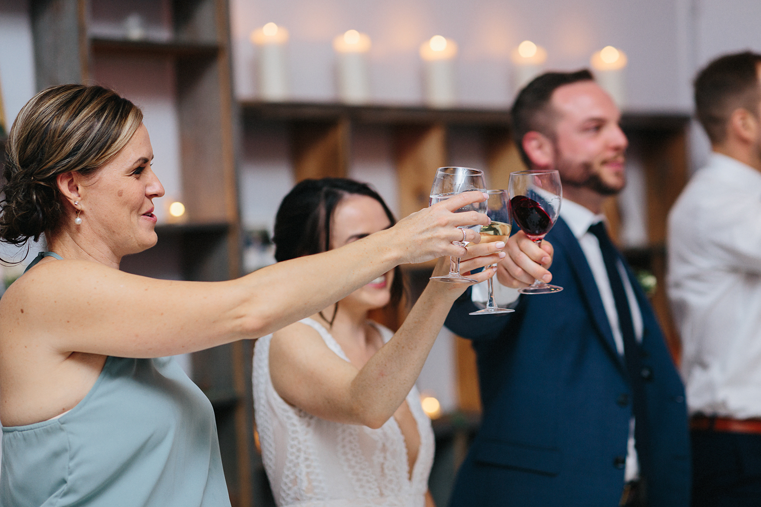 36-Best-Wedding-photographers-Toronto-NAtural-Candid-wedding-photography-Airship37-Reception-Venue-speeches-mom-cheers-toast-bride-and-groom.jpg