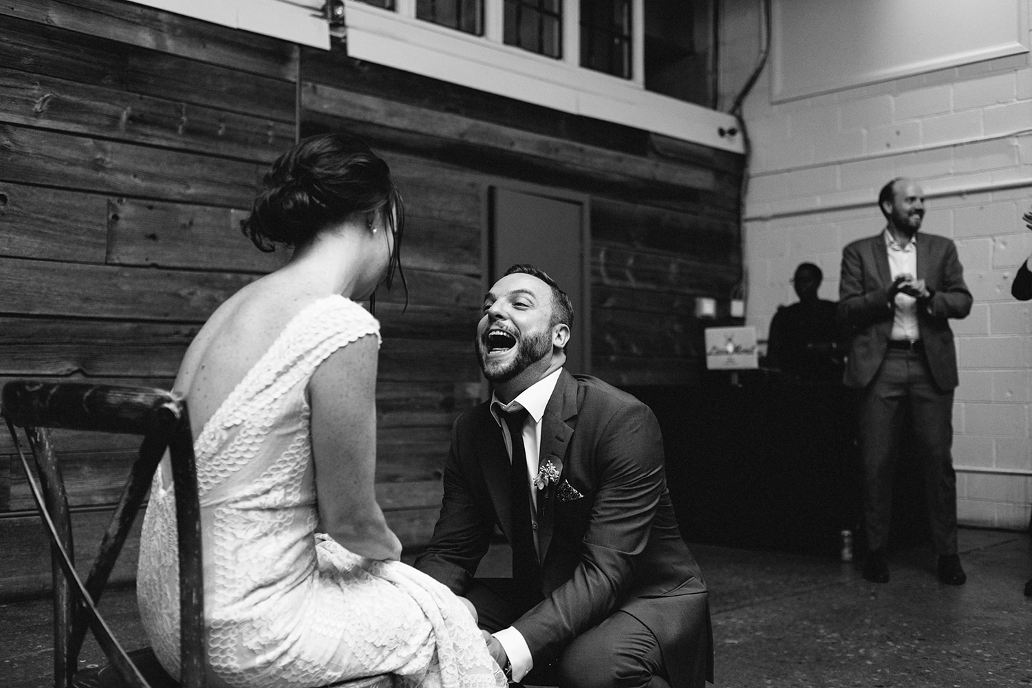 Best-Wedding-photographers-Toronto-NAtural-Candid-wedding-photography-Airship37-Reception-Venue-dance-party-guests-partying-garter-toss-hilarious-bw.jpg