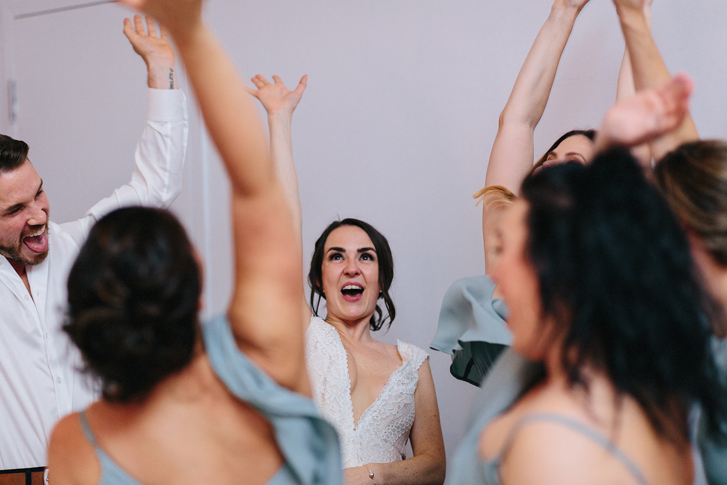 Best-Wedding-photographers-Toronto-NAtural-Candid-wedding-photography-Airship37-Reception-Venue-bride-tribe-cheering.jpg