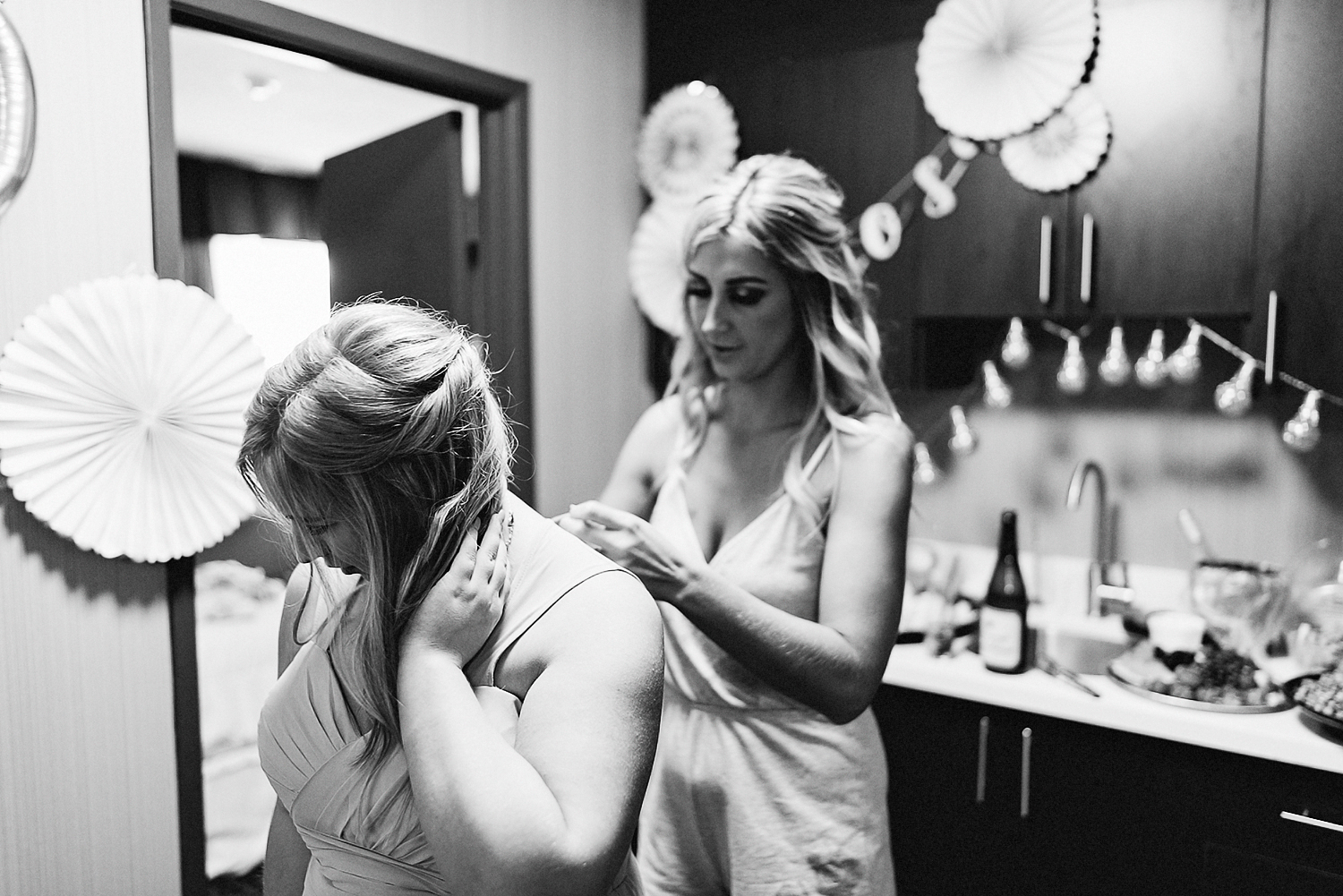 dowswell-barn-wedding-beaverton-best-wedding-photographers-toronto-moody-style-candid-photojounalistic-approach-intimate-vintage-farm-wedding-foggy-morning-details-bride-getting-ready-room-bridesmaid-and-bride-sisters.jpg
